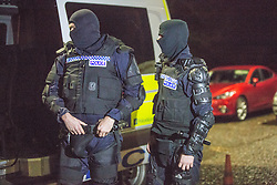Police getting ready at Stirling police station. Police take part in an operation against drug dealers in the Stirling area early this morning.