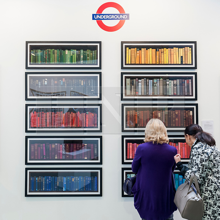 """© Licensed to London News Pictures. 19/05/2016. London, UK. Visitors view Phil Shaw's """"Londonensi Subterraneis"""".  Art16 opens at Olympia, in west London.  Now in its fourth edition, the fair brings together over 100 galleries from more than 30 countries showcasing a diverse cross-section of work by contemporary artists from around the world for buyers and art enthusiasts to visit. Photo credit : Stephen Chung/LNP"""