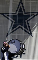 October 8, 2017 - Arlington, TX, USA - A member of the Dallas Cowboys Drum Line performs in the west party zone before the a game against the Green Bay Packers at AT&T Stadium in Arlington, Texas, on Sunday, Oct. 8, 2017. (Credit Image: © Brad Loper/TNS via ZUMA Wire)