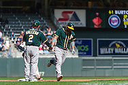 Derek Norris #36 of the Oakland Athletics is congratulated by 3rd base coach Mike Gallego after hitting a 3-run home run in the 11th inning against the Minnesota Twins on April 9, 2014 at Target Field in Minneapolis, Minnesota.  The Athletics defeated the Twins 7 to 4.  Photo by Ben Krause