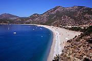 Sandy beach in the bay at Olu Deniz, Fethiye, Turkey