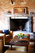 In the winery reception room, a big log fire place and comfortable couches to sit on. Bodega Juanico Familia Deicas Winery, Juanico, Canelones, Uruguay, South America