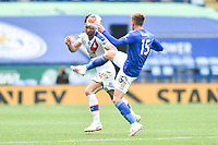LEICESTER, ENGLAND - JULY 04: Gary Cahill of Crystal Palace attempts to head clear from Harvey Barnes of Leicester City during the Premier League match between Leicester City and Crystal Palace at The King Power Stadium on July 4, 2020 in Leicester, United Kingdom. Football Stadiums around Europe remain empty due to the Coronavirus Pandemic as Government social distancing laws prohibit fans inside venues resulting in all fixtures being played behind closed doors. (Photo by MB Media)