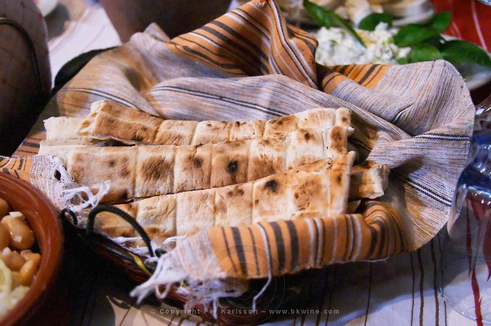 Traditional bread in a bread basket. Pita type bread called kulaç kulac. Tradita traditional restaurant, Shkodra. Albania, Balkan, Europe.