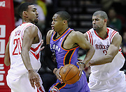 Jan 12, 2011; Houston, TX, USA; Oklahoma City Thunder point guard Russell Westbrook (0) drives to the basket while guarded by Houston Rockets small forward Shane Battier (31) and power forward Jared Jeffries (20) during the fourth quarter at the Toyota Center. The Thunder won 118-112. Mandatory Credit: Thomas Campbell-US PRESSWIRE
