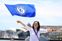 A fan waves Chelsea flags in Dovlet Bayraq Meydani before the UEFA Europa League final at The Olympic Stadium, Baku, Azerbaijan.