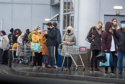 © Licensed to London News Pictures. 21/12/2020. London, UK. Shoppers form long queues to enter Sainsbury's Supermarket on Ladbroke Gove in West London as panic buying starts due to the UK and France border being closed. A new faster spreading strain of COVID-19 has caused a number of countries to ban travel from the UK . Photo credit: Ben Cawthra/LNP