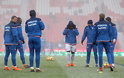 Stoke City players warm up before the match begins