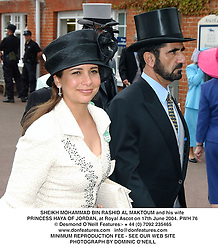 SHEIKH MOHAMMAD BIN RASHID AL MAKTOUM and his wife PRINCESS HAYA OF JORDAN, at Royal Ascot on 17th June 2004.PWH 76
