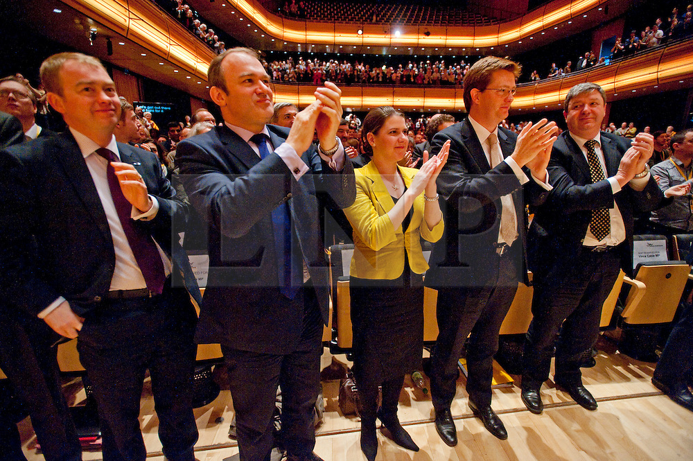 © London News Pictures. 11/03/2012.  Gateshead, UK. L to R Tim Farron, Ed Davey, Jo Swinson, Danny Alexander and Alistair Carmichael applaud Leader of the Liberal Democrats NICK CLEGG at the end of his leaders speech on the final day of the Liberal Democrat Spring conference at the Sage Gateshead on March 11th, 2012. Photo credit : Ben Cawthra/LNP