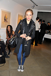 Singer FLORRIE ARNOLD at a private view of jewellery by Eugenie Nairchos and Noor Fares entitled Galactic Garden held at Shizaru Mayfair, 112 Mount Street, London on 5th December 2012.