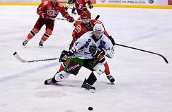 Harlan Pratt of Olimpija and Andrej Hebar of Jesenice at 14th Round of EBEL league  ice hockey match between HK Acroni Jesenice and HDD Tilia Olimpija Ljubljana, on October 16, 2009, in Arena Podmezakla, Jesenice. Acroni Jesenice won 7:5. (Photo by Vid Ponikvar / Sportida)