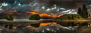Dawn panorama near Lake Pukaki, Nor West sky, cloud over Ben Ohau Range, Mackenzie Country, New Zealand