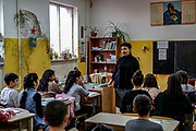 Children during a Russian Language lesson with their teacher Mirzjanyan Nonna from Hadrut at Primary school No 10. Members of the National Assembly of the Nagorno-Karabakh Republic are working on a draft law to make Russian the second official language of Nagorno Karabakh, the first one being Armenian. Children of Primary School Number Ten are learning at the renovated building, which was damaged in shelling attacks during 44 days of the war in Stepanakert, Nagorno-Karabakh. The region saw an end of the conflict after a ceasefire agreement was signed by the leaders of Armenia, Russia and Azerbaijan on 9 November to end the military conflict in Nagorno-Karabakh. Azerbaijani government established the Karabakh Region Authority (KRU) for the districts of Nagorno-Karabakh that came under Baku's control. The city of Stepanakert (Khankendi) is now under the jurisdiction of the KRU of the Ministry of Justice of Azerbaijan. (Photo/ Vudi Xhymshiti)