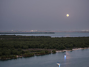 Full moon rises over the Mangrove National Park,  one of the Emirate's most important ecological asset.