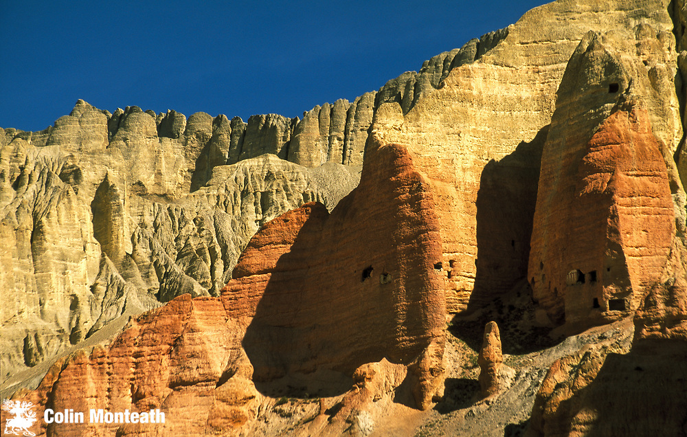 Meditation caves cut into solid rock cliffs, above Dhakmar village, Kingdom of Mustang, Nepal