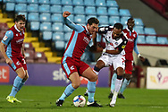 Harrison McGahey ,Nathan Delfouneso  during the EFL Sky Bet League 2 match between Scunthorpe United and Bolton Wanderers at the Sands Venue Stadium, Scunthorpe, England on 24 November 2020.