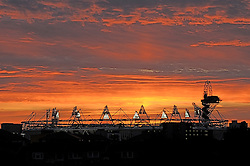 © Licensed to London News Pictures. 11/08/2011. London, UK.  The sun setting over the Olympic Stadium and ArcelorMittal Orbit in the Olympic Park on August 11, 0212. Photo credit: Peter Adams/LNP