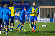 AFC Wimbledon defender Ben Heneghan (22) warming up before kick off during the EFL Sky Bet League 1 match between AFC Wimbledon and Hull City at Plough Lane, London, United Kingdom on 27 February 2021.