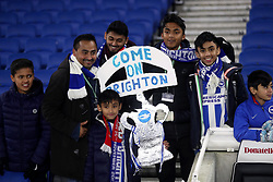 Brighton & Hove Albion fans in the stands with a replica FA cup trophy