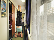 Woman does Yoga in the train (headstand). Unusual.