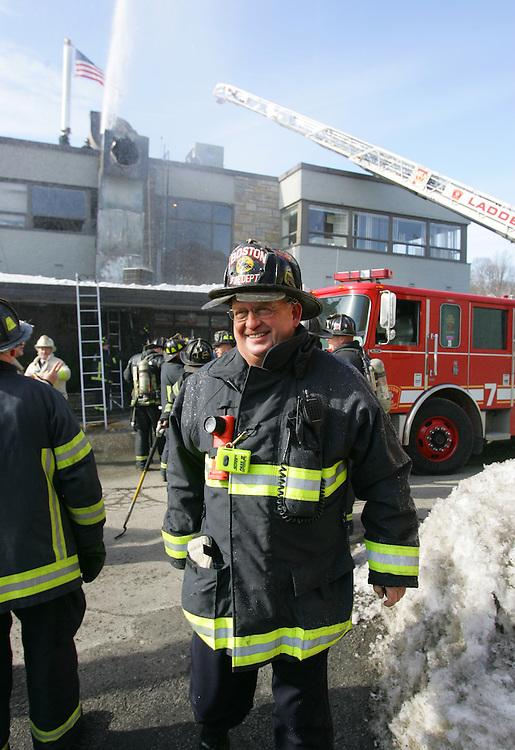 Boston, MA 02/11/2011.Boston Firefighters extinguish a 2 alarm fire in the ventilation system at China Sky restaurant on Gallivan Blvd. in Dorchester on Friday afternoon..Alex Jones / www.alexjonesphoto.com