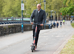 © Licensed to London News Pictures; 04/05/2021; Bristol, UK. Current Mayor of Bristol MARVIN REES tries out a Voi rental scooter on a visit to Bristol by Angela Rayner, Deputy Leader of the Labour Party, during the local and regional elections campaign, supporting Labour Mayoral candidate Marvin Rees who is the current elected Mayor of Bristol and other Labour candidates for the city council, police and crime commissioner, and West of England Combined Authority Mayor. Photo credit: Simon Chapman/LNP.