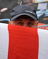 © under license to London News Pictures. 22/11/2010. A man hides his face.  English Defence League founder Stephen Lennon appears in court today (Monday) in West London accused of assaulting a police officer on the anniversary of Armistice Day. Lennon was arrested during a counter protest against a hardline Islamic group. Photo credit should read: Stephen Simpson/LNP