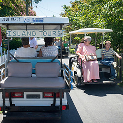 August 4, 2017 - Tangier Island, VA - Day tripper visitors to Tangier Island take island tours on multi-seater golf carts around the island. <br /> Photo by Susana Raab/Institute