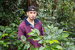 """Elieser Valle, el Pacayito, Colinas. Elisier is a member of the COCASJOL coffee cooperative. """"With Eta our land began to subside, to sink, but when Iota came and the rain, the land began to slip away, down the mountain. Most of the coffee farm is affected, and it's affecting the house, it's what worries us most at the moment, the house is on the edge of the landslide now. We don't sleep well, when the hurricanes were in full swing we had to stay in another house for a while, we were too scared to sleep here. Thank God we are okay, but if this carries on we'll have to abandon the house. We aren't the only ones, there are other families in the same situation. We are in danger of losing everything, the coffee farm and the house."""""""