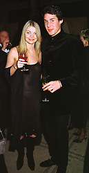 MISS JEMMA KIDD and MR DAVID DE ROTHSCHILD a member of the banking family, at a fashion show in London on 17th November 1998.MMC 80