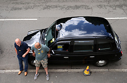 A taxi in a rank outside the grounds wait for spectators on day nine of the Wimbledon Championships at The All England Lawn Tennis and Croquet Club, Wimbledon.