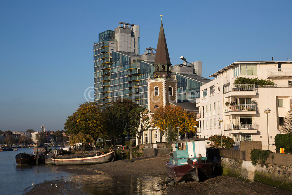 St Mary's Church in Battersea surrounded by modern apartment buildings. This is the new face of London, as new build apartments are filling up every space along the riverside of the River Thames. In particular around this area near Chelsea and Wandsworth. London, UK.