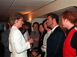 File photo dated 01/12/93 of Princes Diana, Patron of the National Aids Trust talking to George Michael (second right) as Mick Hucknall looks on ahead of a concert of Hope at Wembley Arena in London, to mark World Aids Day. Pop superstar Mr Michael has died peacefully at home, his publicist said.