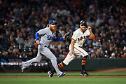San Francisco Giants right fielder Hunter Pence (8) is tagged out by Los Angeles Dodgers third baseman Justin Turner (10) during a pickle at AT&T Park in San Francisco, California, on September 13, 2017. (Stan Olszewski/Special to S.F. Examiner)
