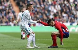 April 8, 2018 - Madrid, Madrid, Spain - Lucas Vazquez (Real Madrid) help Lucas Hernandez (Club Atletico de Madrid) get up Real Madrid and Atletico de Madrid FC at Estadio Santiago Bernabeu. (Credit Image: © Manu Reino/SOPA Images via ZUMA Wire)