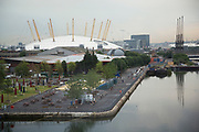 Looking out at the O2 over the old docks in the docklands area of London. Also known once as The Millennium Dome, this is now a major success as a music venue in the heart of East London.