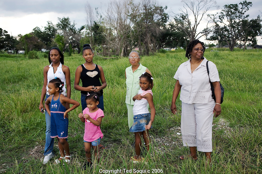 The Moses family women, four generations, stand upon the area where their home once was. 2039 Deslonde St. in the Lower 9th Ward of New Orleans.