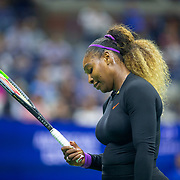 2019 US Open Tennis Tournament- Day Three.  Serena Williams of the United States reacts during her match against Catherine McNally of the United States in the Women's Singles Round Two match on Arthur Ashe Stadium at the 2019 US Open Tennis Tournament at the USTA Billie Jean King National Tennis Center on August 27th, 2019 in Flushing, Queens, New York City.  (Photo by Tim Clayton/Corbis via Getty Images)