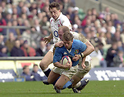 Twickenham, Surrey, 9th March2003, Six nations International Rugby,  RFU Stadium, England, [Mandatory Credit; Peter Spurrier/Intersport Images]<br /> Photo Peter Spurrier<br /> 09/03/2003<br /> RBS Six Nations Rugby England v Italy<br /> Italian centre Giovanni Raineri is tackled by Lawrence Dallaglio