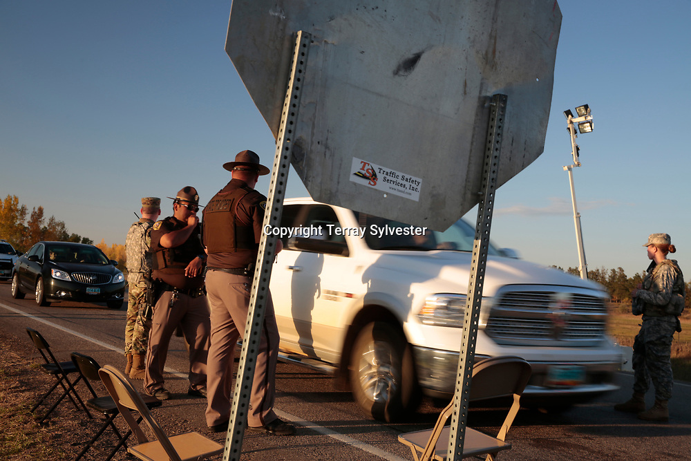 Police officers and National Guard soldiers man a checkpoint on State Highway 1806 north of the Dakota Access oil pipeline route on October 1, 2016. North Dakota, United States.
