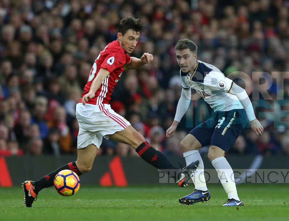 Christian Eriksen of Tottenham and Matteo Darmian of Manchester United during the English Premier League match at Old Trafford Stadium, Manchester. Picture date: December 11th, 2016. Pic Simon Bellis/Sportimage
