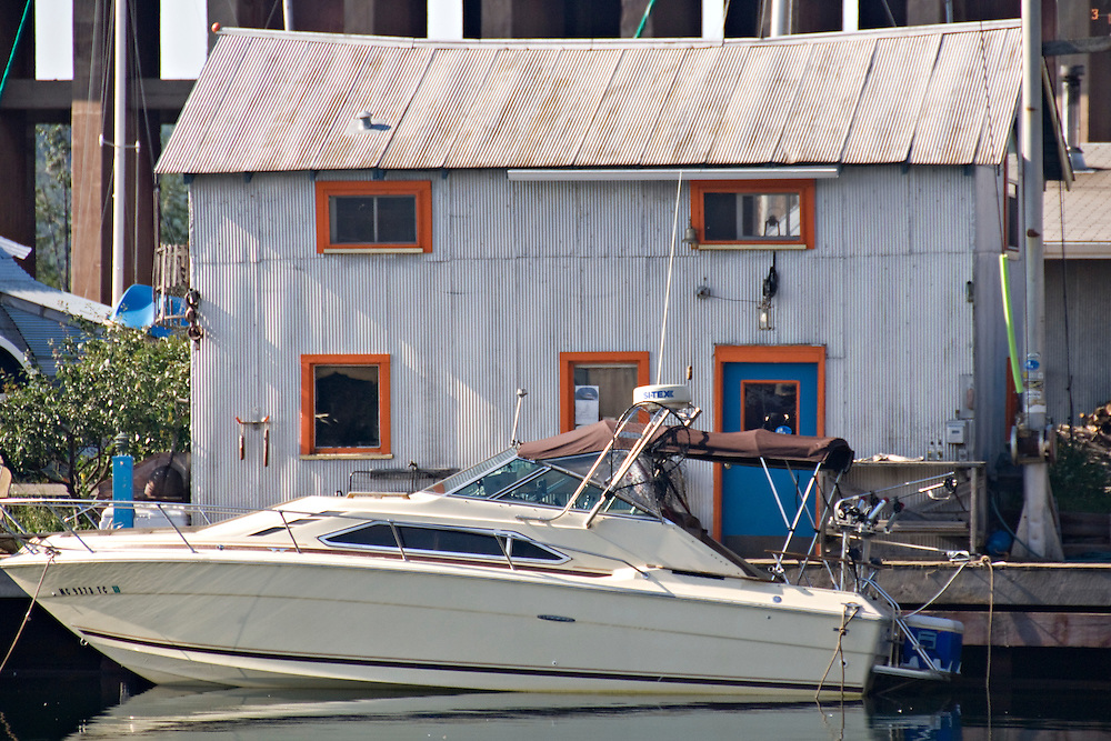 Power boat and old fishing building in the lower harbor of Marquette Michigan.