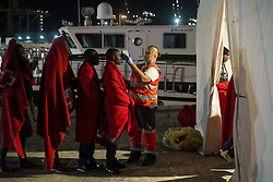 October 1, 2018 - Malaga, Spain - A red Cross staff takes the temperature of a migrant. on 1st October 2018 in Malaga, Spain. The Spanish Maritime vessel rescued 148 persons from three different dinghies in the Mediterranean sea. They were brought to the Malaga port. Among them were 20 women and 2 minors. (Credit Image: © Guillaume Pinon/NurPhoto/ZUMA Press)