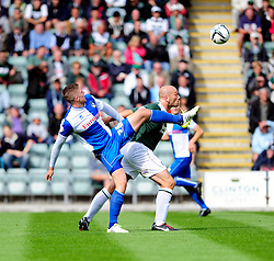 Bristol Rovers' Ryan Brunt jostles for the ball with Plymouth Argyle's Guy Branston  - Photo mandatory by-line: Dougie Allward/JMP - Tel: Mobile: 07966 386802 07/09/2013 - SPORT - FOOTBALL -  Home Park - Plymouth - Plymouth Argyle V Bristol Rovers - Sky Bet League Two