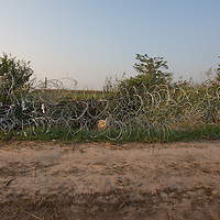 Razor wire fence is seen sabotaged by illegal migrants on the border between Hungary and Serbia near Roszke (about 174 km South of capital city Budapest), Hungary on September 01, 2015. ATTILA VOLGYI