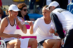 Katarina Srebotnik and Polona Hercog of Slovenia with coach Iztok Bozic  during doubles against Rebecca Marino and Sharon Fichman of Canada at the second day of the tennis Fed Cup match between Slovenia and Canada at Bonifika, on April 17, 2011 in Koper, Slovenia. Slovenia won 3-2 and stays in World Group II.  (Photo by Vid Ponikvar / Sportida)