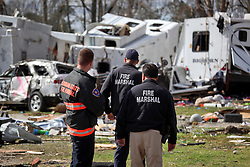 24 February 2016. Sugar Hill RV Park, Convent, Louisiana.<br /> Scenes of devastation following a deadly EF2 tornado touchdown. 2 confirmed dead. <br /> Fire marshals survey the damage from the powerful storm.<br /> Photo©; Charlie Varley/varleypix.com