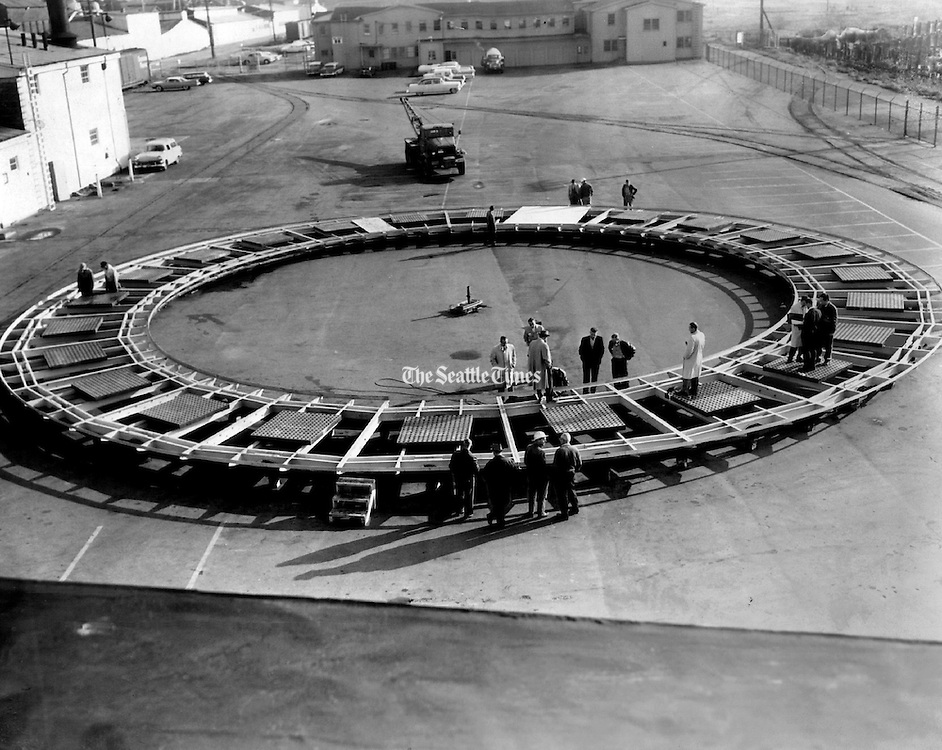 With fine precision, the Eye of the Needle restaurant turntable went through a shakedown spin at the Western Gear Corp.'s Everett plant today. (Vic Condiotty / The Seattle Times, 1961)