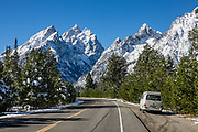 Snow-covered Teewinot Mountain (on left 12,325 feet) and Grand Teton (center 13,775 ft) in Grand Teton National Park, Wyoming, USA. On right is Storm Point. Grand Teton is the highest mountain in the Park.